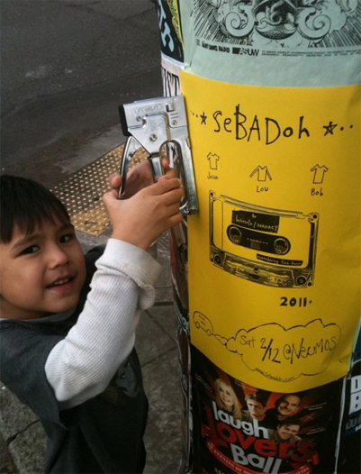 Mucho puts up Sebadoh posters, Carlos Valdez photo